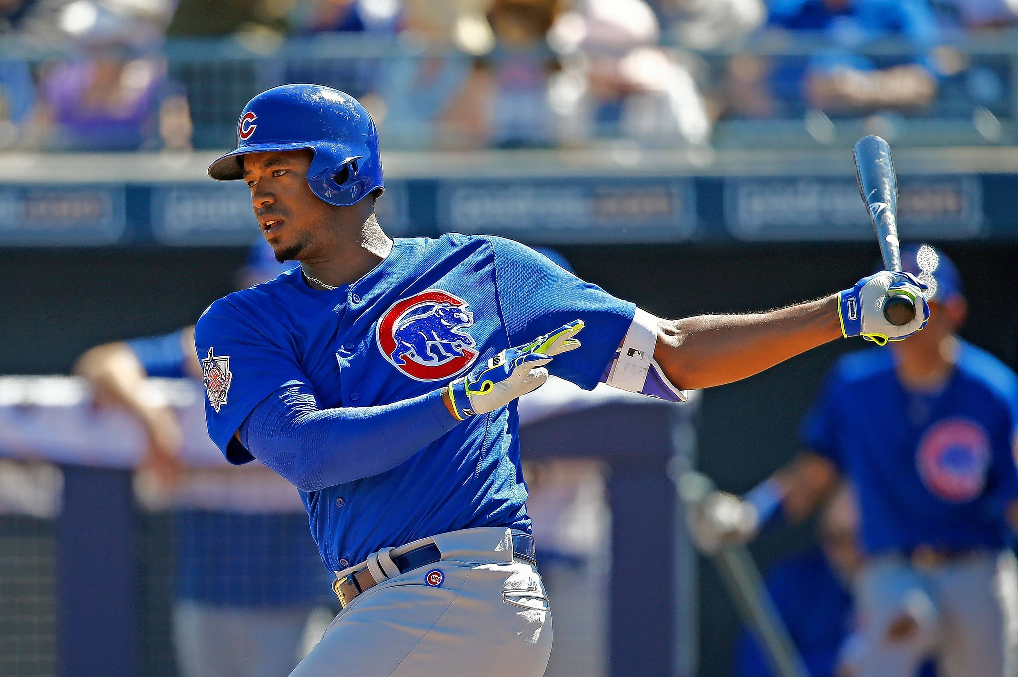 Former Chicago Cubs right fielder Eloy Jimenez, now in the White Sox organization, takes a swing against the Seattle Mariners during the second inning of a spring training baseball game Friday, March 10, 2017, in Peoria, Ariz. The Mariners defeated the Cubs 11-10. (AP Photo/Ross D. Franklin)