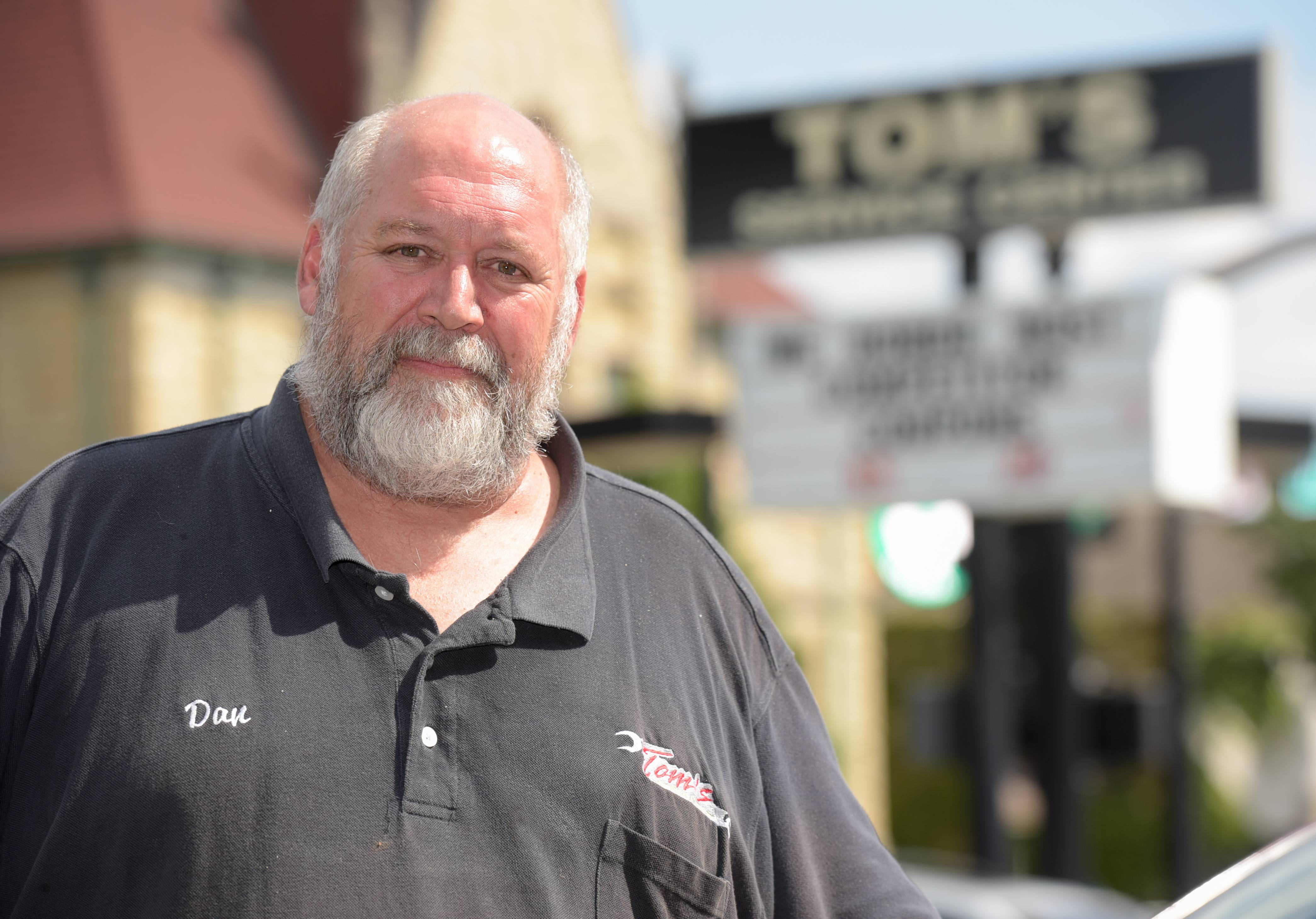 Dan Kullman, owner of Tom's Service Station, a fixture in downtown Wheaton for almost 50 years, will close Aug. 23.