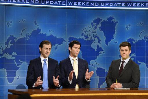"This August 10, 2017, photo provided by NBC shows Alex Moffat as Eric Trump, left, Mikey Day as Donald Trump Jr., center, and Colin Jost on set during the debut episode of ""Weekend Update: Summer Edition,"" in New York.NBC's summer run of ""Weekend Update"" segments from ""Saturday Night Live"" and ABC's two-part special on Princess Diana were modest successes for their television networks last week. The Nielsen company said nearly 4.9 million watched ""SNL's"" Michael Che and Colin Jost deliver topical jokes from their fake newsroom set last week. NBC is giving the ""Saturday Night Live"" fake newscast a four-week midsummer run. Its numbers were particularly good among the younger viewers NBC seeks.(Rosalind O'Connor/NBC via AP, File)"