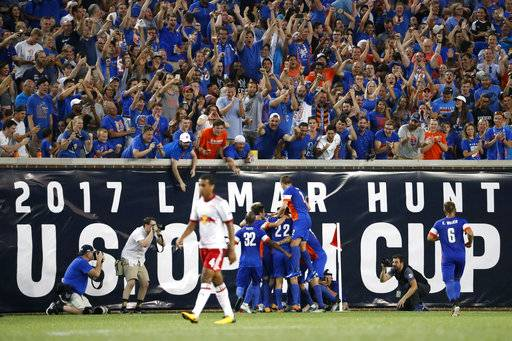 FC Cincinnati players celebrate after midfielder Corben Bone scores in the first half of a U.S. Open Cup soccer semi-final match against the New York Red Bulls, Tuesday, Aug. 15, 2017, in Cincinnati. (AP Photo/John Minchillo)