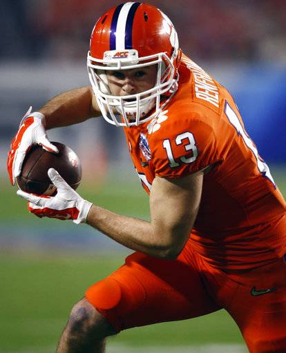 FILE - In this Dec. 31, 2016, file photo, Clemson wide receiver Hunter Renfrow (13) runs with the ball during the Fiesta Bowl NCAA college football game against Ohio State, in Glendale, Ariz. Renfrow, whose TD catch led to a national title, is already a folk-hero for Tiger fans. Now, he'd like to be a regular contributor and main cog of the offense. (AP Photo/Rick Scuteri, File)