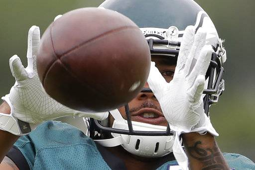 Philadelphia Eagles running back DJ Pumphrey catches a ball during an NFL football training camp in Philadelphia, Tuesday, Aug. 15, 2017. (AP Photo/Matt Rourke)