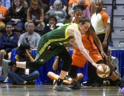 FILE - In this Aug. 8, 2017, file photo, Seattle Storm forward Brianna Stewart, foreground, chases a loose ball against Connecticut Sun forward Alyssa Thomas during the first half of a WNBA basketball game at the Mohegan Sun Arena in Uncasville, Conn. Struggling Seattle hopes the coaching change last week to replace Jenny Boucek with Gary Kloppenburg helps the team turn things around. Kloppenburg got off to a good start with the Storm winning at Phoenix in his first game in charge. (Tim Martin/The Day via AP, File)