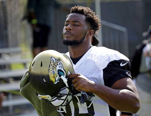"FILE- In this July 28, 2017, file photo, Jacksonville Jaguars defensive end Dante Fowler Jr., arrives at practice during NFL football training camp in Jacksonville, Fla. Fowler is determined to alter his image and change his reputation. Fowler was arrested twice in 17 months, including once in July. ""From now on, when people say my name, I want them to talk about a soft-hearted, good guy,� he said. ""A teddy bear off the field but a monster on the field. I don't need to be doing the monstrous stuff off the field.� (AP Photo/John Raoux, File)"