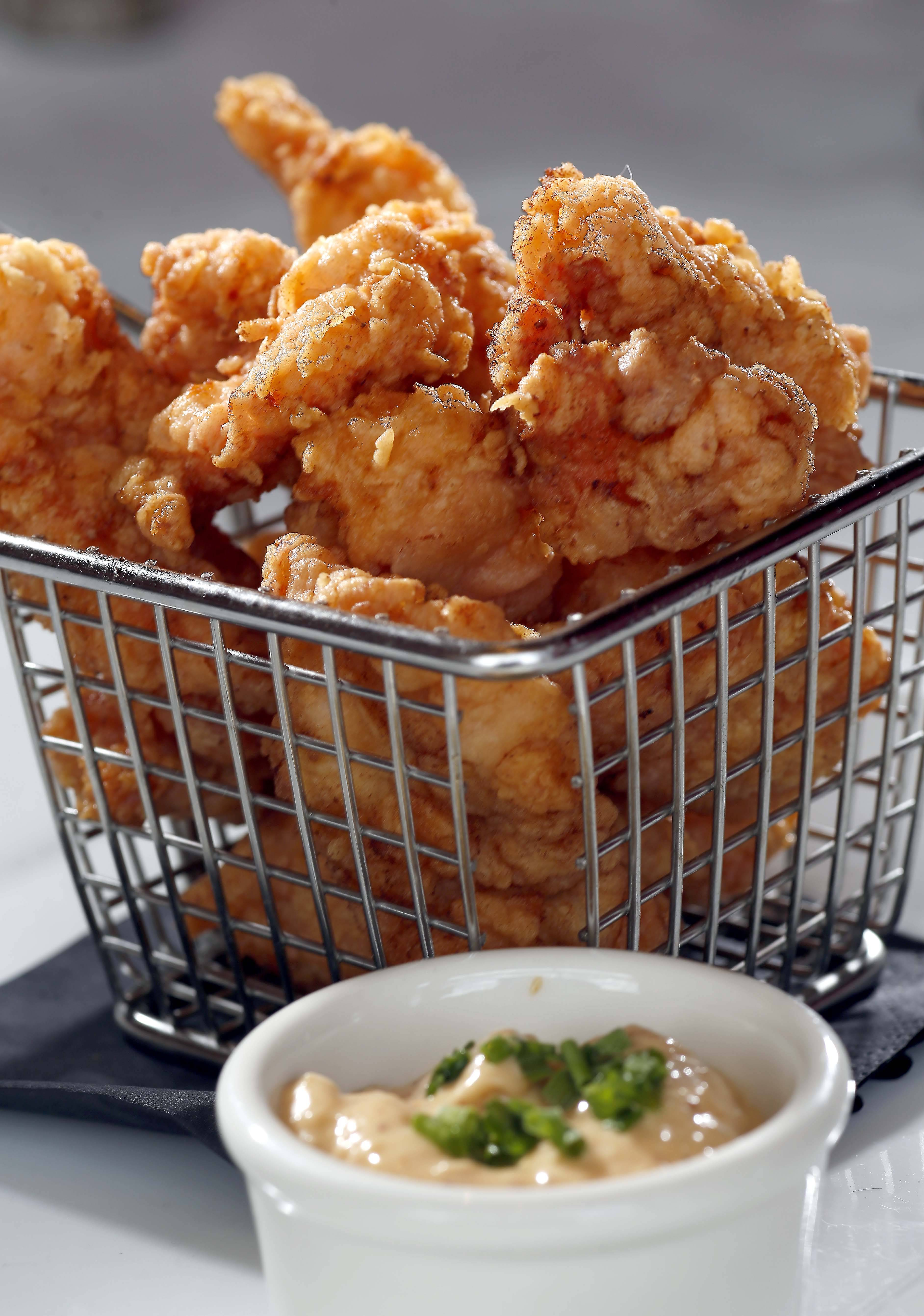 The Southern fried alligator tail is served with horseradish aioli at Bold American Fare in Algonquin.