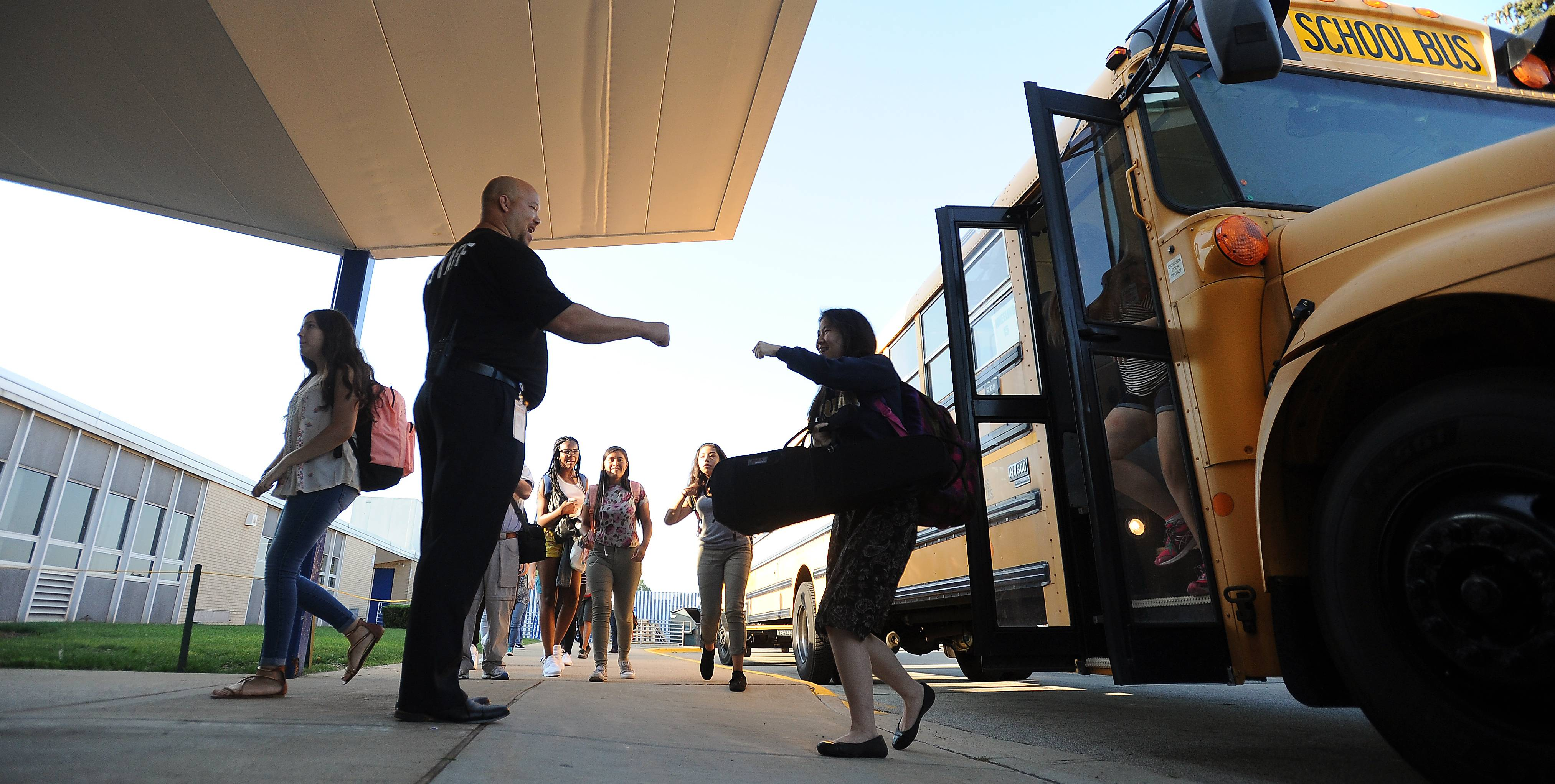 New Wheeling High School Principal Jerry Cook gives a fist bump to a student arriving to school Wednesday morning for the first day of school.
