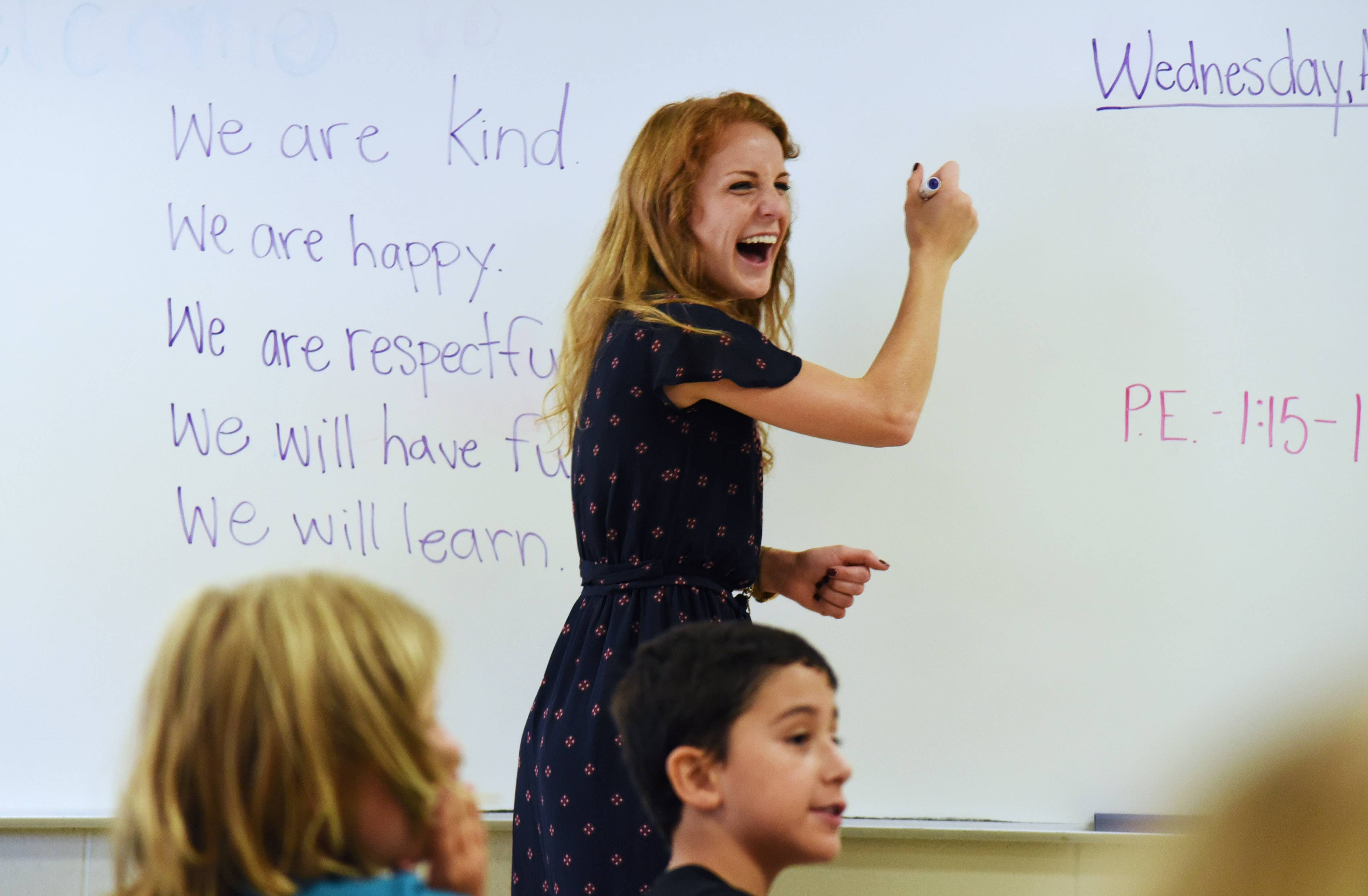 Wauconda Grade School teacher Alexandra Maggio shares a laugh with her second-grade students as they come up with a list of rules and goals for the new school year. Wauconda CUSD 118 held first day of classes on Wednesday.