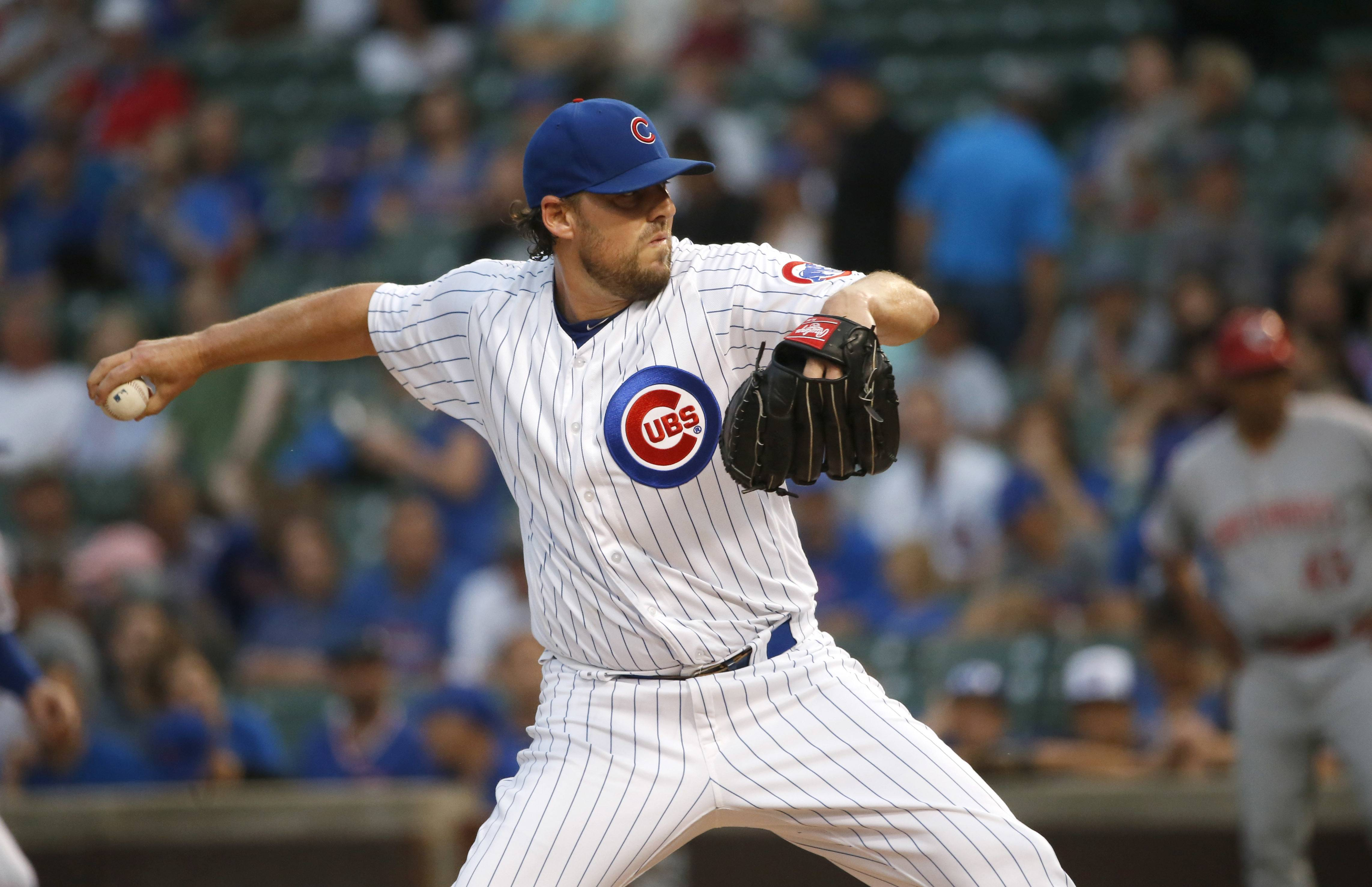 Chicago Cubs starting pitcher John Lackey delivers during the first inning of a baseball game against the Cincinnati Reds Wednesday, Aug. 16, 2017, in Chicago.