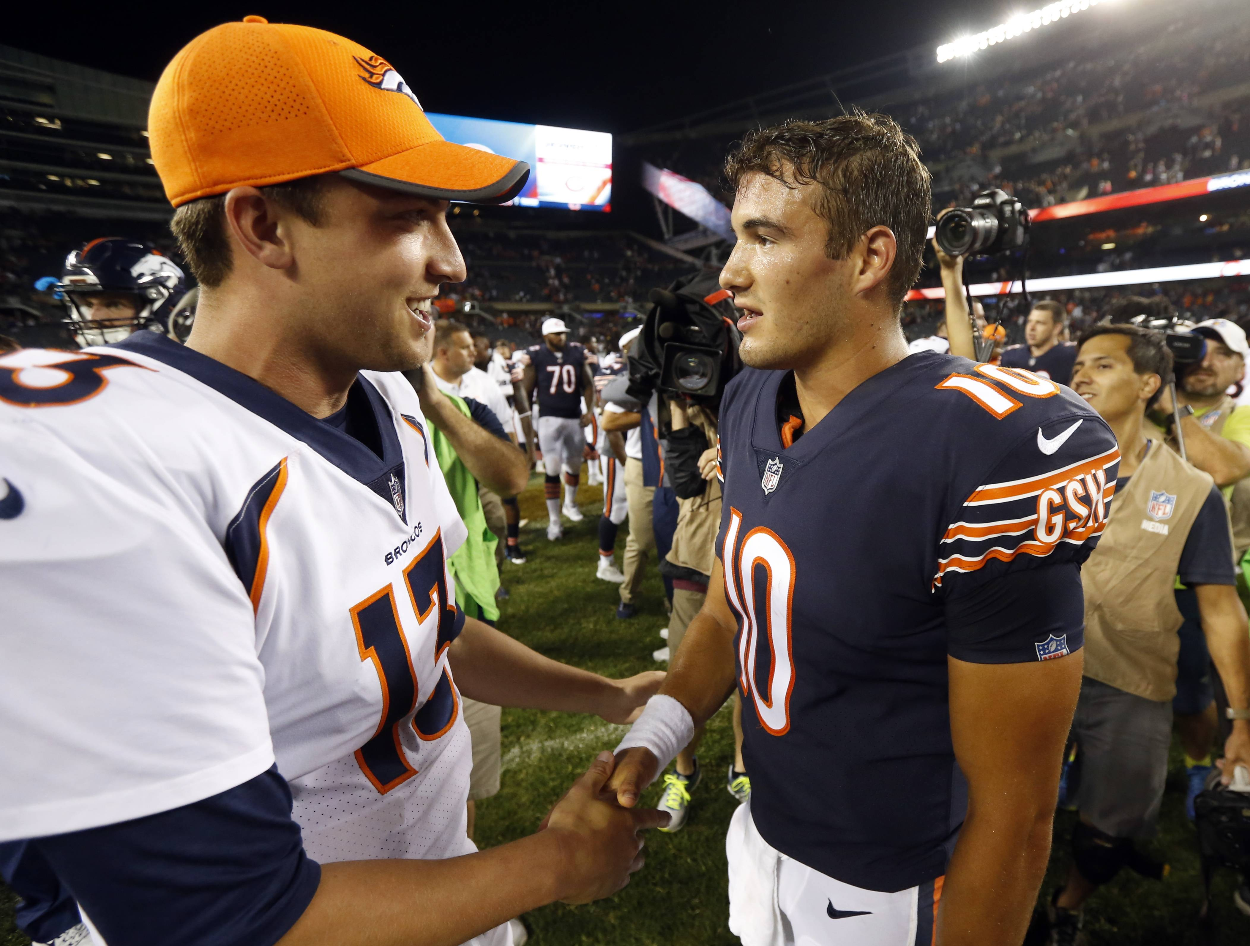 Denver Broncos quarterback Trevor Siemian (13) shakes hands with Chicago Bears quarterback Mitchell Trubisky (10) after an NFL preseason football game, Thursday, Aug. 10, 2017, in Chicago. The Broncos won 24-17. (AP Photo/Charles Rex Arbogast)