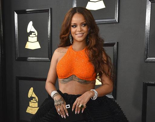 "FILE - In this Feb. 12, 2017, file photo, Rihanna arrives at the 59th annual Grammy Awards in Los Angeles. Calvin Harris, who wrote and produced Rihanna's hit ""We Found Love,� is set to perform at the singer's charity event on Sept. 14, 2017. Rihanna said Wednesday, Aug. 16, 2017, that the Scottish DJ-producer will join fellow performer Kendrick Lamar and host Dave Chappelle for her third Diamond Ball. (Photo by Jordan Strauss/Invision/AP, File)"