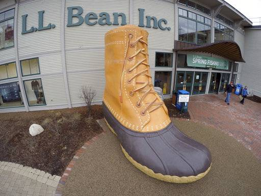 "FILE - In this March 16, 2016, file photo, shoppers exit the L.L. Bean retail store in Freeport, Maine. L.L. Bean hopes to give the boot to backlogs of its most iconic product. The Maine-based retailer is expanding production to keep up with demand for its leather-and-rubber ""duck boot� with a new manufacturing center that's being unveiled Thursday, Aug. 17, 2017. The company also plans to hire more than 100 additional production workers at two locations in Maine. (AP Photo/Robert F. Bukaty, File)"