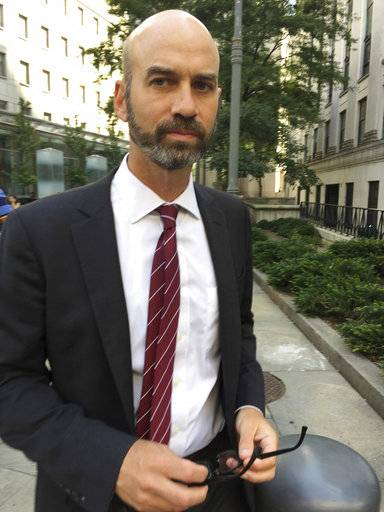 James Bennet, editorial page editor of The New York Times, leaves federal court on Wednesday, Aug. 16, 2017, in New York. Bennet was grilled in federal court by a lawyer for Sarah Palin, who's suing over an editorial that linked right-wing political rhetoric to the 2011 shooting of former U.S. Rep. Gabby Giffords. (AP Photo/Larry Neumeister)