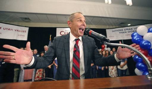 Provo Mayor John Curtis celebrates after winning Utah's Republican primary to fill the U.S. House seat vacated by Jason Chaffetz Tuesday, Aug. 15, 2017, in Provo, Utah. Curtis of Provo, defeated former state lawmaker Chris Herrod and business consultant Tanner Ainge, son of Boston Celtics president Danny Ainge. (AP Photo/Rick Bowmer)