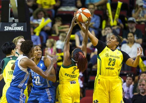 Seattle Storm forward Kaleena Mosqueda-Lewis (23) and guard Alexis Patterson (2) come up with the defensive board against the Minnesota Lynx during the first half of a WNBA basketball game Wednesday, Aug. 16, 2017, in Seattle. (Dean Rutz/The Seattle Times via AP)
