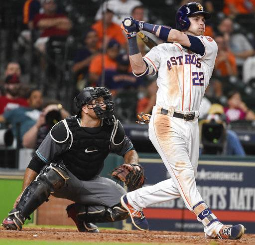Houston Astros' Josh Reddick follow through on a two-run home run off Arizona Diamondbacks relief pitcher Andrew Chafin during the eighth inning of a baseball game, Wednesday, Aug. 16, 2017, in Houston. (AP Photo/Eric Christian Smith)