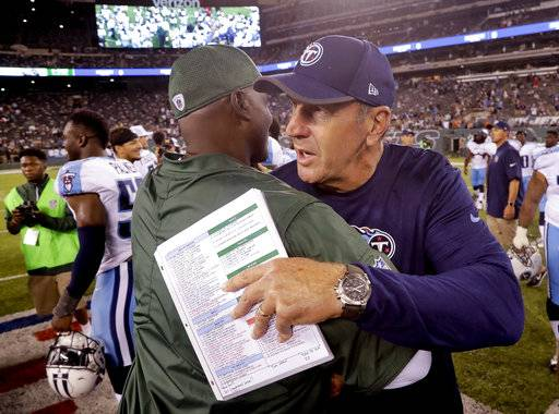 Tennessee Titans head coach Mike Mularkey greets New York Jets head coach Todd Bowles after an NFL football game, Saturday, Aug. 12, 2017, in East Rutherford, N.J. The Jets won 7-3. (AP Photo/Julio Cortez)