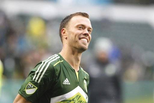 FILE - In this Oct. 16, 2016, file photo, Portland's Jack Jewsbury reacts after Portland's 1-0 win against the Colorado Rapids in a Major League Soccer match at Providence Park in Portland, Ore. After retiring last season, three players stayed with the Portland Timbers in another capacity. Former captain Jack Jewsbury is now Portland's director of business development, while fellow midfielder Ned Grabavoy was named director of scouting and recruitment. Defender Nat Borchers _ who spent most of his career in Salt Lake _ joined the Timbers' broadcast team. (Billy Gates/The Oregonian via AP, File)