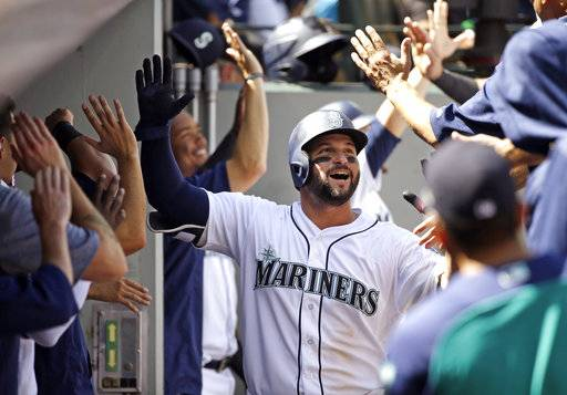 Seattle Mariners' Yonder Alonso is congratulated on his two-run, home run against the Baltimore Orioles in the fourth inning of a baseball game Wednesday, Aug. 16, 2017, in Seattle. (AP Photo/Elaine Thompson)