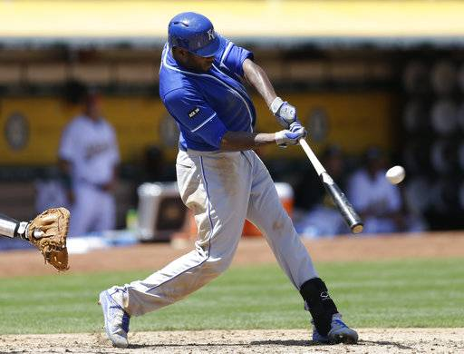 Kansas City Royals' Lorenzo Cain connects for a two run home run off Oakland Athletics' Paul Blackburn in the fourth inning of a baseball game Wednesday, Aug. 16, 2017, in Oakland, Calif. (AP Photo/Ben Margot)