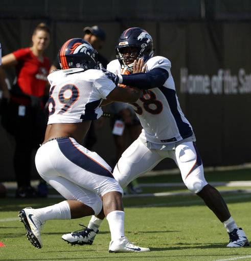 Denver Broncos' Von Miller, right, and Deon Hollins go through drills during a joint NFL football practice Wednesday, Aug. 16, 2017, in Santa Clara, Calif. (AP Photo/Marcio Jose Sanchez)