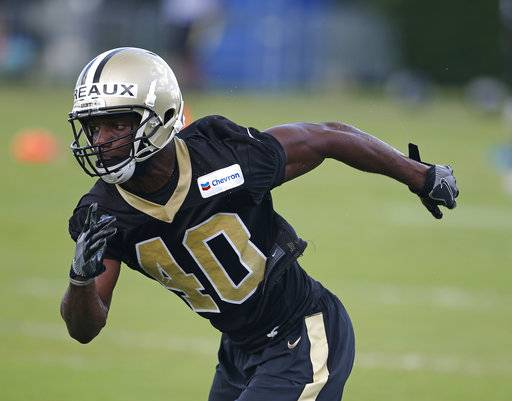 FILE - In this June 15, 2017, file photo, New Orleans Saints cornerback Delvin Breaux (40) goes through drills during NFL football practice in Metairie, La. Saints coach Sean Payton says cornerback Delvin Breaux needs lower-leg surgery that will sideline him about six weeks and that the initial misdiagnosis of Breaux's injury has sparked a shakeup in the team's medical staff. (AP Photo/Gerald Herbert, File)