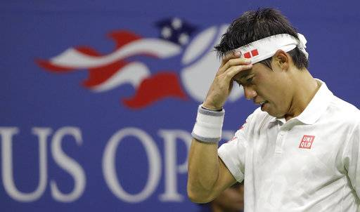 FILE - In this Sept. 9, 2016, file photo, Kei Nishikori, of Japan, adjusts his head band between serves to Stan Wawrinka, of Switzerland, during the semifinals of the U.S. Open tennis tournament, in New York. Nishikori is the latest top player to pull out of the U.S. Open because of an injury. The agent for the 2014 runner-up and 2016 semifinalist at Flushing Meadows says Nishikori is going to miss the rest of this season because of a torn tendon in his right wrist. (AP Photo/Darron Cummings, File)