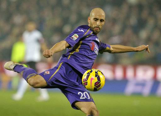FILE - In this , Dec. 14, 2014 file photo, Fiorentina's Borja Valero kicks the ball during a Serie A soccer match between Cesena and Fiorentina at Manuzzi stadium in Cesena, Italy, Sunday. nother Fiorentina export, this Spanish passing wizard could provide Inter Milan with the touch of class that it lacked during a tumultuous campaign last season that included four managerial changes. At 32, Valero has long been overlooked by Spain's national team but he was a fan favorite at Fiorentina. (AP Photo/Marco Vasini, File)