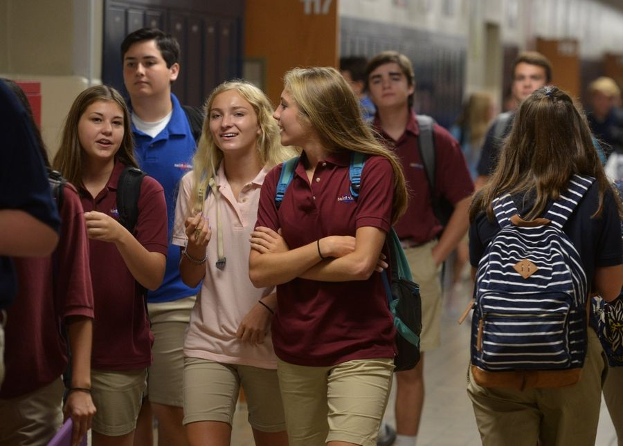 St. Viator High School students pass through the hallway between the first and second period during the first day of classes Thursday in Arlington Heights.