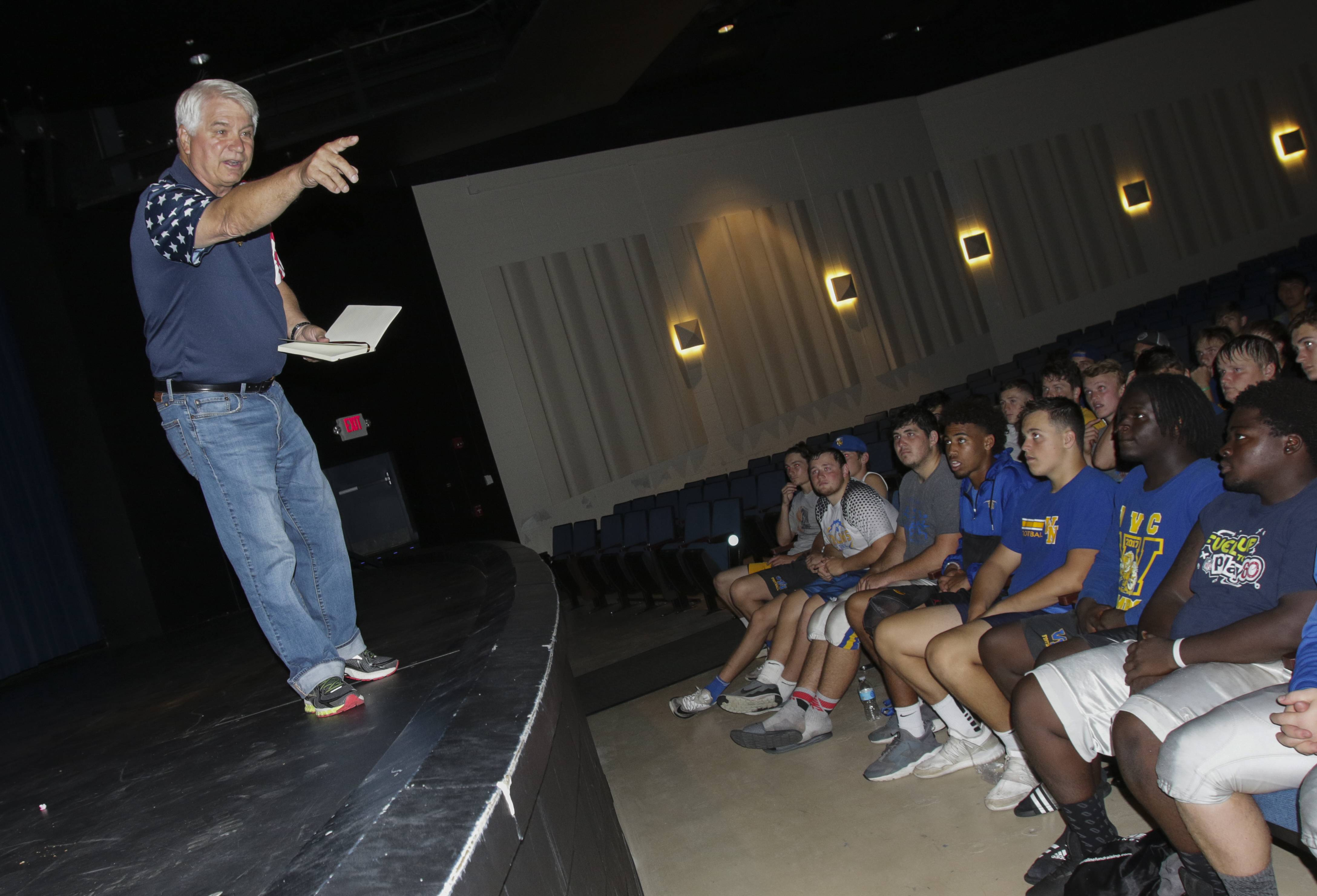 Jim McCloughan, a Medal of Honor recipient, speaks to Wheaton North High School football players on Thursday.