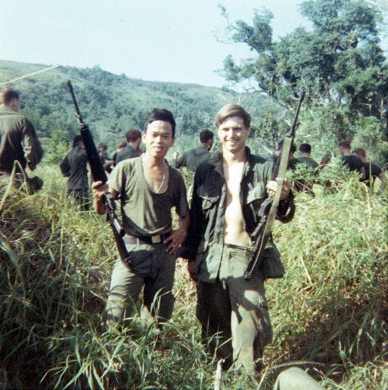 James McCloughan is shown in 1969 with a platoon interpreter in Vietnam.