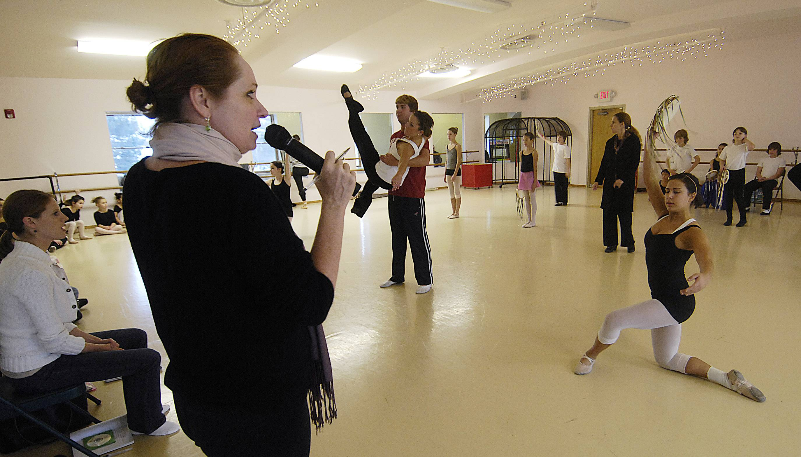 "Linda Cunningham uses a microphone to direct a dress rehearsal of ""The Nutcracker"" at State Street Dance Studio in Geneva. State Street has closed, but Cunningham has been asked to direct a Bloomingdale dance company's production of the holiday favorite."