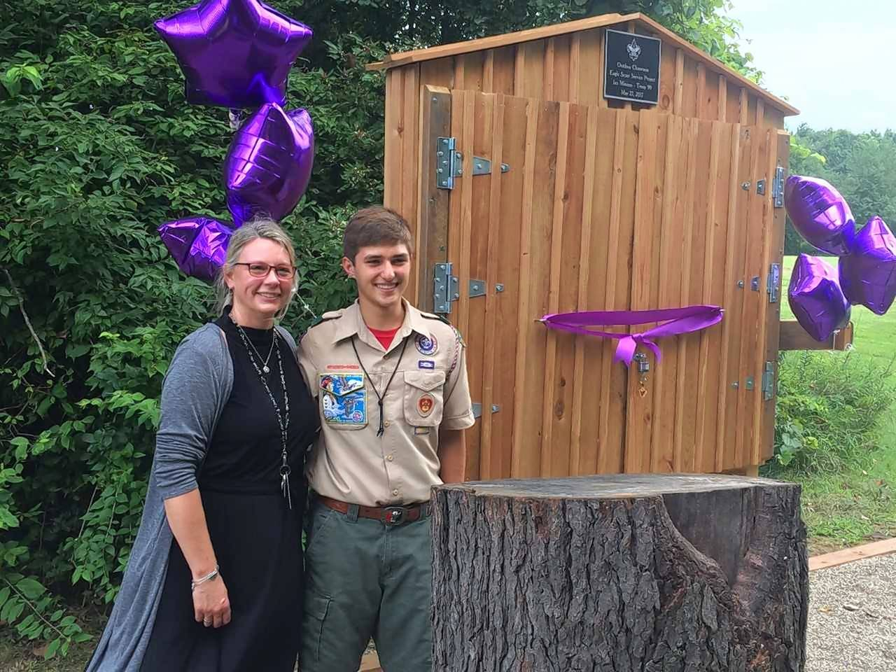 Cotton Creek School Principal Diane Kelly joined Ian Mininni at the dedication for the outdoor classroom he created as an Eagle Scout project.