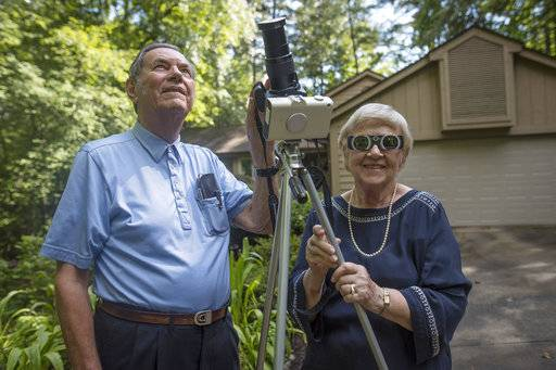 Donald and Norma Liebenberg stand in the driveway of their home in Salem, S.C. Donald has seen and blogged about his 26 eclipses for Clemson University where he does research, and holds the record for most time in totality because the retired federal scientist used to chase them by airplane whenever possible. But in 2017, the celestial event will come to him.