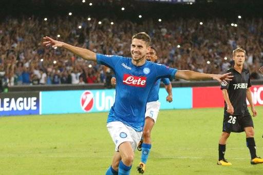Napoli's Jorginho celebrates after scoring during a Champions League playoff round, first leg soccer match between Napoli and Nice at San Paolo stadium in Naples, Wednesday, Aug. 16, 2017. (Cesare Abbate/ANSA Via AP)