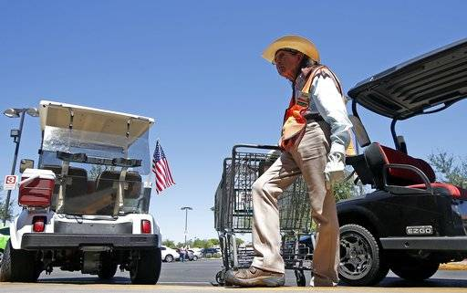 Although he didn't vote in the last presidential election, David Ash, 64, of Sun City, Ariz., talks about his support of President Donald Trump at a local grocery store Wednesday, Aug. 16, 2017, in Sun City, Ariz. (AP Photo/Ross D. Franklin)