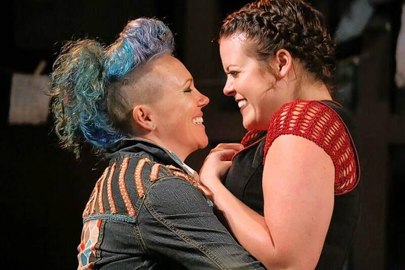"Courtier Touchstone (Courtney Abbott), left, and shepherdess Audrey (Sierra Schnack) fall in love in First Folio Theatre's production of William Shakespeare's ""As You Like It."" Casting two women instead of a man and a woman has generated some controversy for the Oak Brook theater."