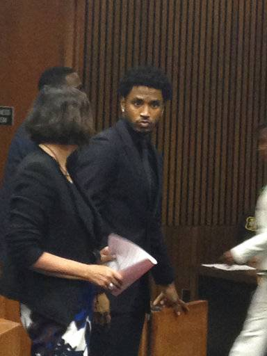 R&B singer Trey Songz appears in court to enter a plea on Friday, Aug. 18, 2017 in Detroit. The 32-year-old artist pleaded guilty Friday to two counts of disturbing the peace in a Wayne County court. He will serve 18 months of probation. Authorities say microphones and speakers were thrown from stage during his December concert at Joe Louis Arena. A police sergeant was punched. Police have said the singer became upset when told to end his performance. (Oralandar Brand-Williams/Detroit News via AP)