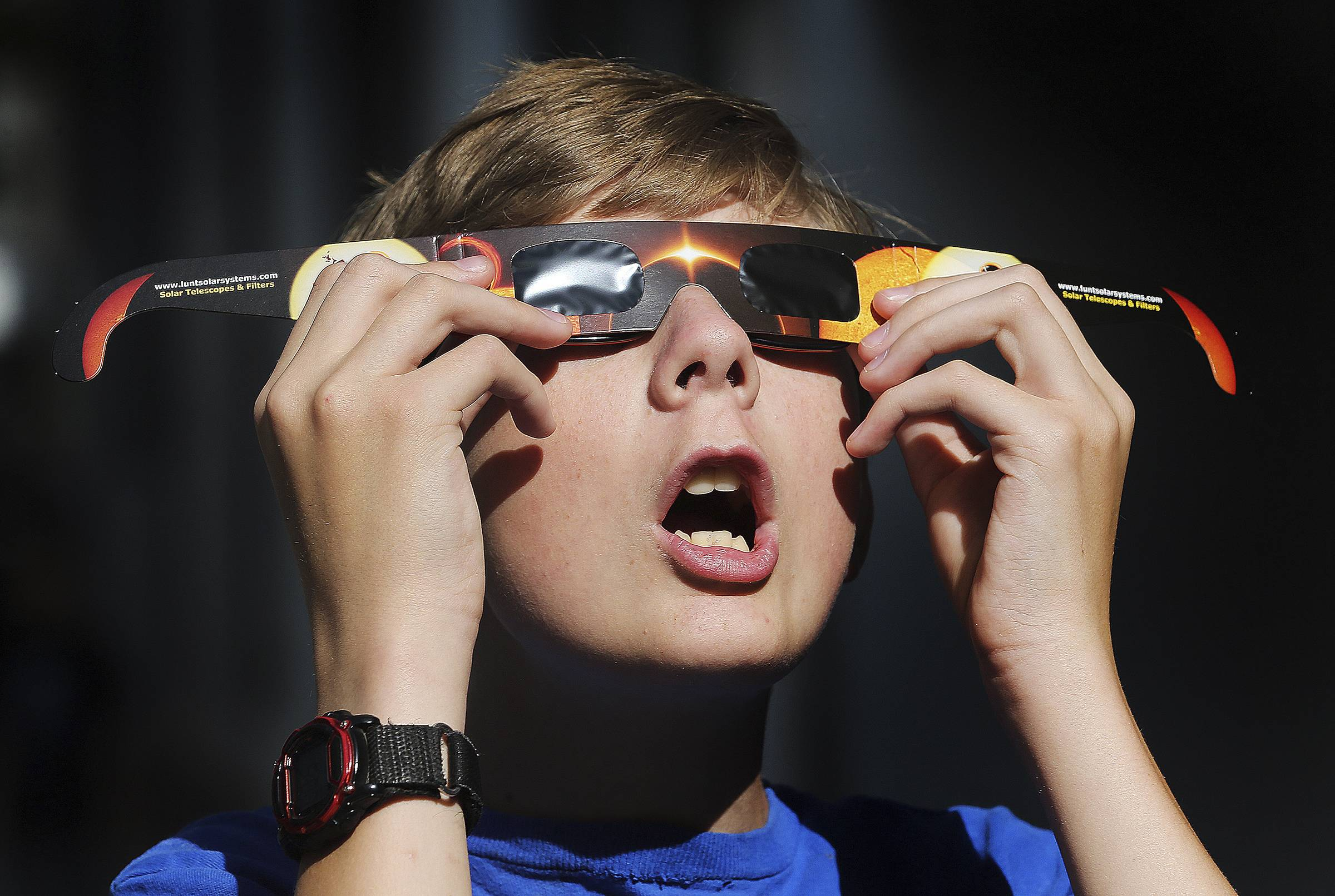Colton Hammer tries out his eclipse glasses in preparation for the eclipse.