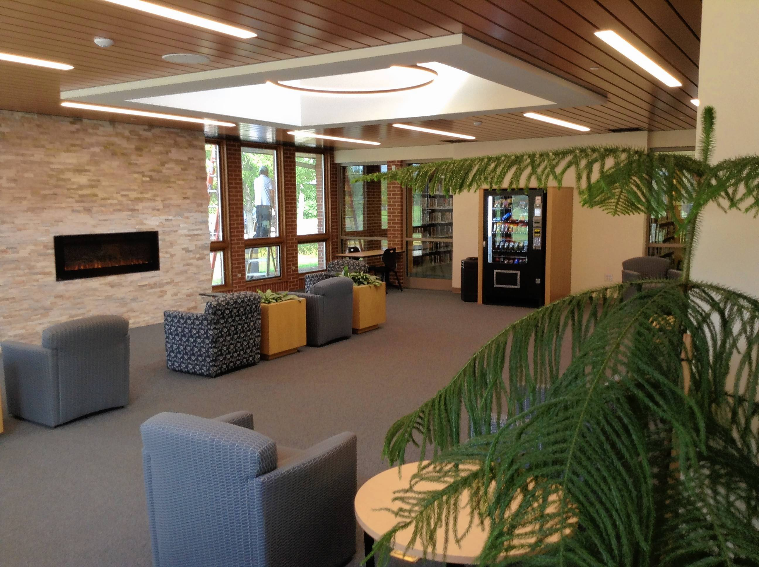 The Rolling Meadows Library's new Garden Lounge includes high-counter seating, charging stations for mobile devices, vending machines and an electronic fireplace.