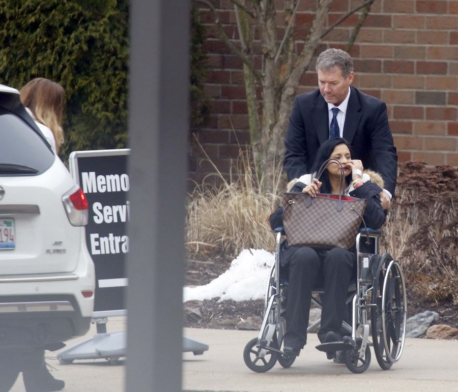 Anjum Coffland, mother of twins Brittany and Tiffany, was escorted into a St. Charles church for her daughters' visitation in March. The girls were shot and killed by their father, Randy.