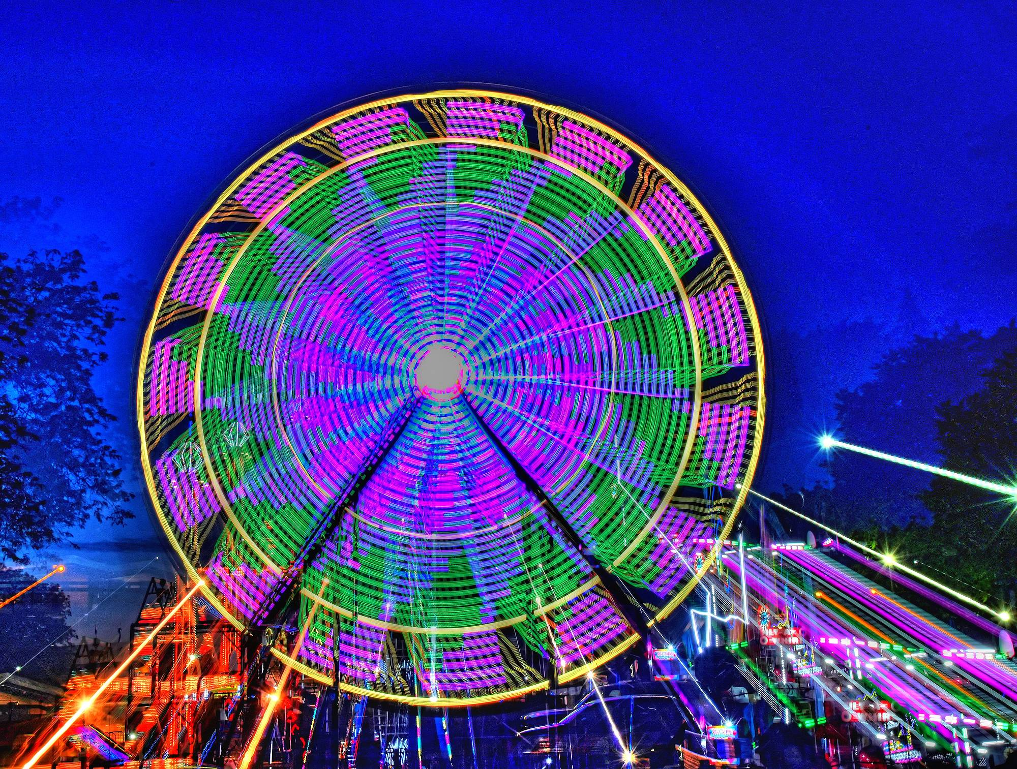 This photo was taken at the Itasca carnival. I decided to try something different from just a time exposure of the Ferris wheel. This is a 3 second exposure, during the exposure I zoomed the lens 24 mm-120 mm to get a different effect. I love the new digital lighting on the wheel because you never know what you will get till the exposure is over.