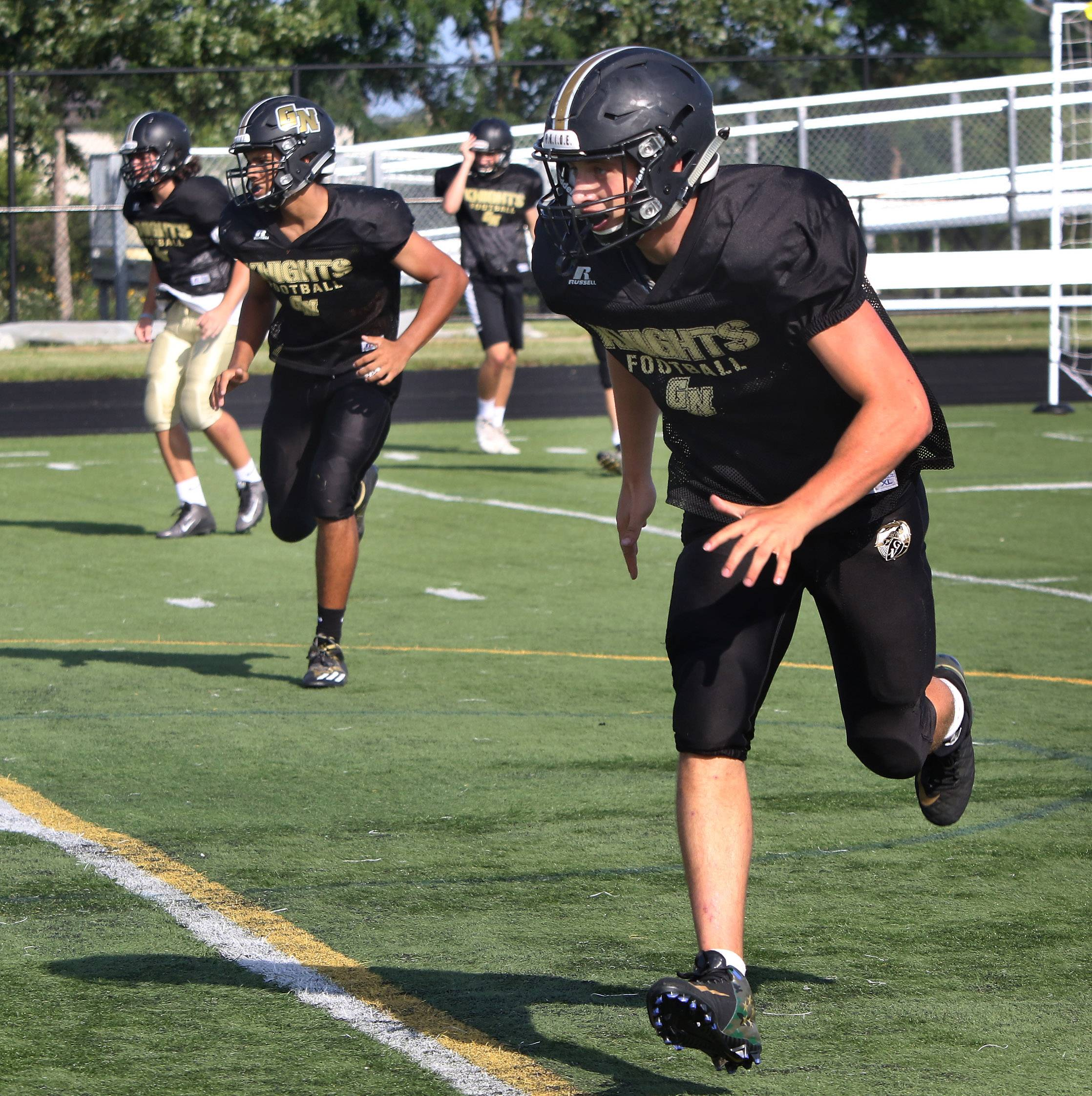 Middle linebacker Will Bauman runs through drills during football practice at Grayslake North.
