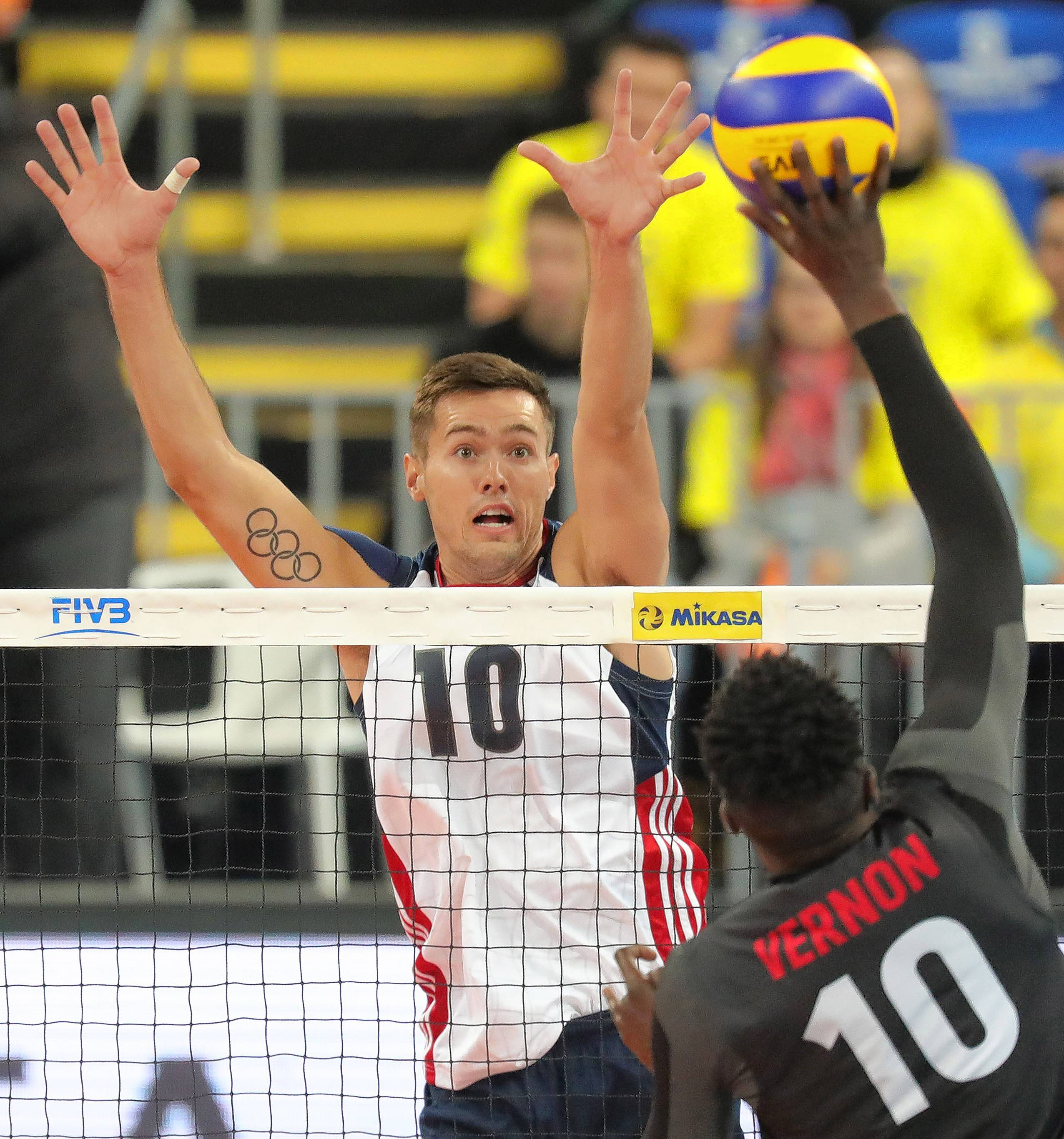 Thomas Jaeschke, left, a former star at Wheaton Warrenville South and Loyola University, will help lead USA Volleyball against Brazil in a series of USAV Cup matches at Sears Centre Arena this weekend.
