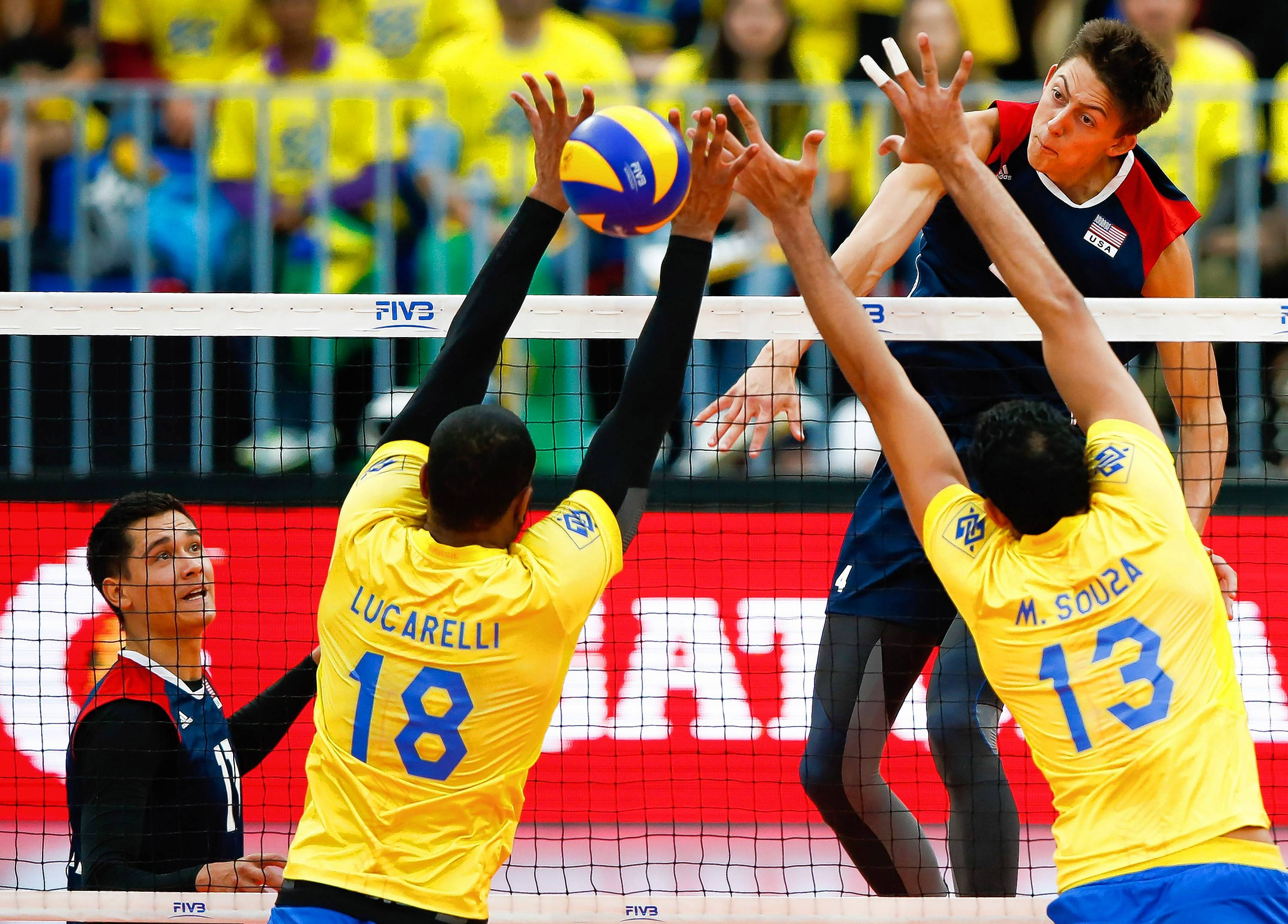 Jeffrey Jendryk, a 6-foot-10 middle blocker from Wheaton for Team USA, spikes against Brazil in a July match.