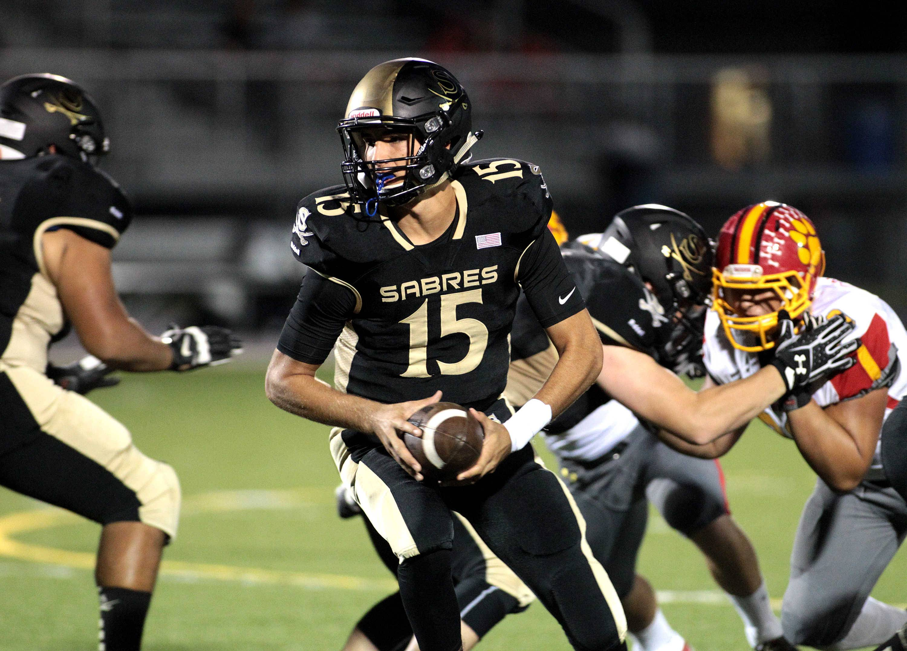 Streamwood quarterback Brendon Marton (15) returns to lead the Sabres.