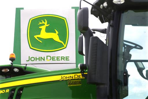 FILE - This Sunday, June 8, 2014, file photo shows John Deere farming equipment at a dealership in Petersburg, Ill. Deere & Co. reports earnings, Friday, Aug. 18, 2017. (AP Photo/Seth Perlman, File)