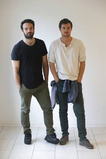 "This Wednesday, Aug. 16, 2017 photo shows actors Charlie Cox and Finn Jones in New York. Cox stars as Daredevil and Jones stars as Iron Fist in the Netflix series, ""The Defenders."" (AP Photo/John Carucci)"