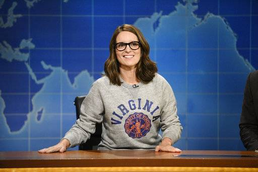 "This Aug. 17, 2017, photo provided by NBC shows Tina Fey on set during the an episode of ""Weekend Update: Summer Edition,"" in New York. Fey, a graduate of the University of Virginia, discussed last weekend's white nationalist rally near the school's Charlottesville, Va. campus, saying it broke her heart ""to see these evil forces descend upon Charlottesville.� (Will Heath/NBC via AP)"