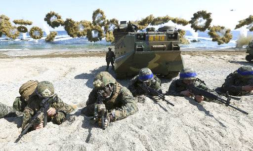 "FILE - In this March 12, 2016 file photo, Marines of the U.S., left, and South Korea wearing blue headbands on their helmets, take positions after landing on a beach during the joint military combined amphibious exercise, called Ssangyong, part of the Key Resolve and Foal Eagle military exercises, in Pohang, South Korea. America's annual joint military exercises with South Korea always frustrate North Korea. The war games set to begin Monday, Aug. 21, 2017 may hold more potential to provoke than ever, given President Donald Trump's ""fire and fury� threats and Pyongyang's as-yet-unpursued plan to launch missiles close to Guam. (Kim Jun-bum/Yonhap via AP, File)"