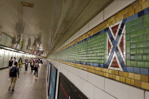 "The mosaic tile design meant to represent Times Square's status as the ""Crossroads of the World"" is part of the subway station's border, in New York, Friday, Aug. 18, 2017. Transit officials have decided to alter subway tiles at the station that have a design that's been compared to the Confederate flag, to make it ""crystal clear"" that they don't depict the flag. (AP Photo/Richard Drew)"